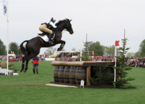 Nicola and Opposition Buzz proving that this spread at Badminton is far too small for them. Not many event horses show this sort of scope around a course of this size! Photo by kind permission of Kath Begley.