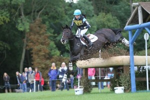 A perfect example of core strength 'stickability'. Here an unfit rider would almost certainly be out the side door, instead the rider recovers well keeping balance and goes on to jump cleanly the second part of the combination only 3 strides later