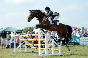 Sailing over the triple bar in the puissance. Photo with permission from http://www.stephburchphotography.co.uk