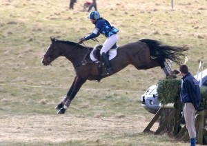 Flying over the open ditch with brush.
